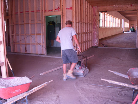 We lay section by section in the barns because we are not the only ones working in there, so we have to be courteous to the other trades. So we will prepare the base, then lay that section in and repeat.